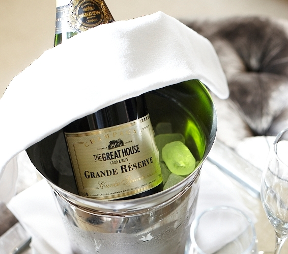 The Great House Champagne in an ice bucket with glasses