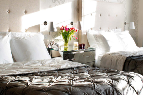 Two double beds with flowers