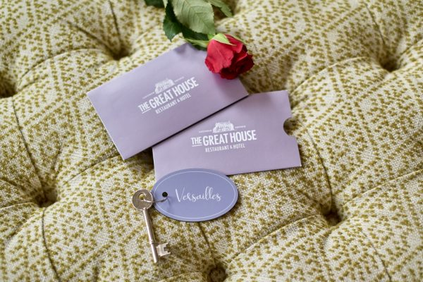 Gift Vouchers on cushion with key and rose